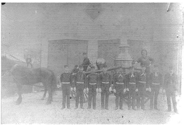 Hook and Ladder Number 1 in front of the fire house in 1887